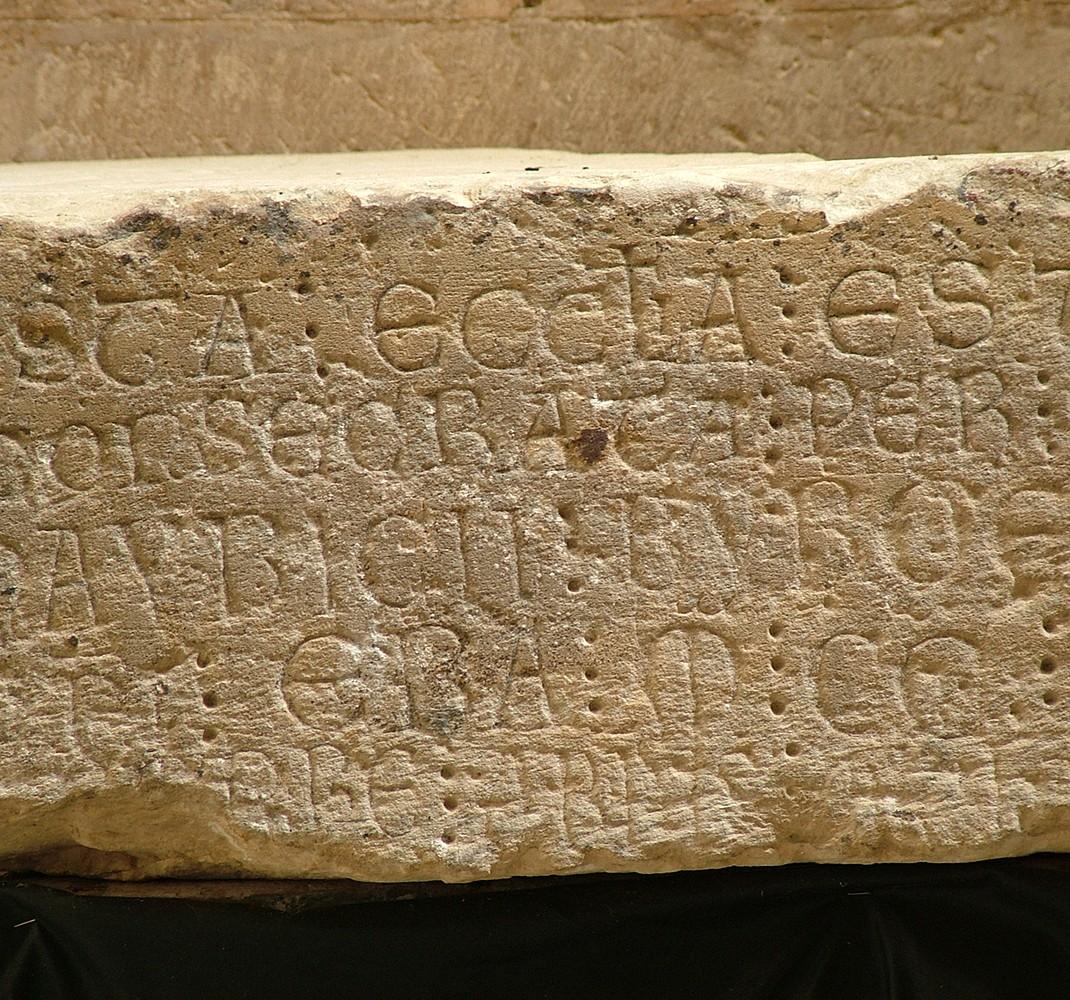 Ashlar with inscription of consecration
